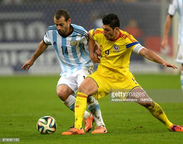 Romania's Ciprian Marica and Argentina's Javier Mascherano battle for the ball