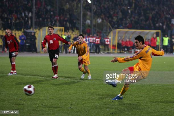 Romania's Ciprian Marica scores from the penalty spot