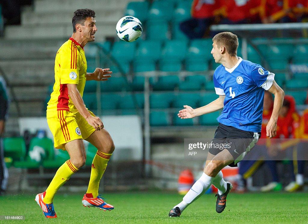 Romania's Ciprian Marica (L) vies with Estonia's Igor Morozov during the FIFA 2014 World Cup qualifying football match Estonia vs. Romania on September 7, 2012 in Tallin. Romania won 2-0. AFP PHOTO / Jarek Joepera