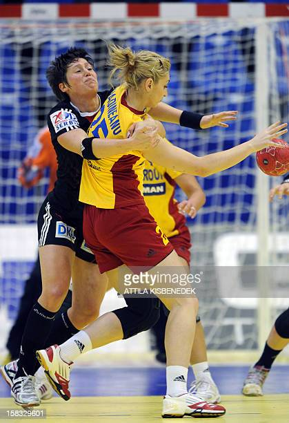 Romania's Clara Vadineanu vies with Germany's Anne Müller during the 2012 EHF European Women's Handball Championship Group II match of main round on...