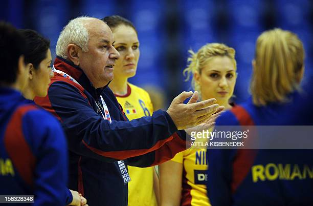 Romania's coach Georghe Tadici speaks to players during the match against Germany during the 2012 EHF European Women's Handball Championship Group II...