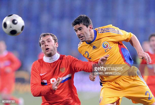 Romania's Cosmin Contra vies for the ball with Russia's Roman Adamov during their friendly football match in Bucharest on March 26 2008 AFP PHOTO /...
