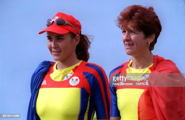 Romania's Coxless Pairs team of Georgeta Damian and Doina Ignat celebrate winning the gold medal