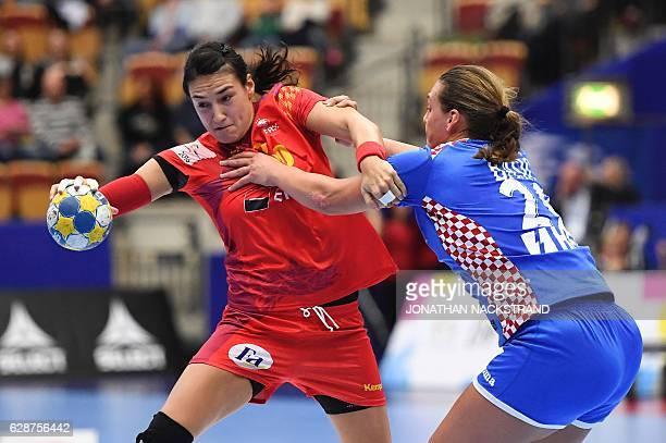 Romania's Cristina Neagu and Croatia's Sonja Basic vie for the ball during the Women's European Handball Championship Group D match between Romania...