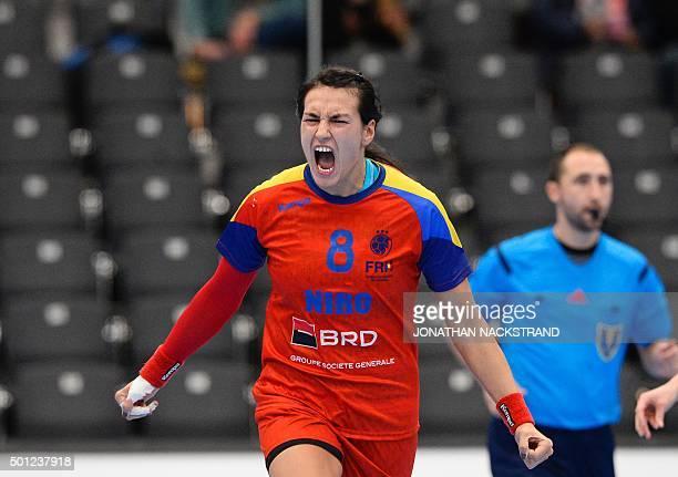 Romania's Cristina Neagu celebrates after scoring a goal during the 2015 Women's Handball World Championship eight final match between Brazil and...