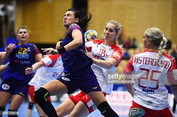 Romania's Cristina Neagu is stoped by Denmarks Mette Tranborg during the Women's European Handball Championship group 2 main round match between...