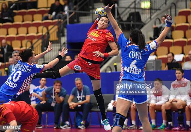 Romania's Cristina Neagu prepares to throw the ball during the Women's European Handball Championship Group D match between Romania and Croatia in...