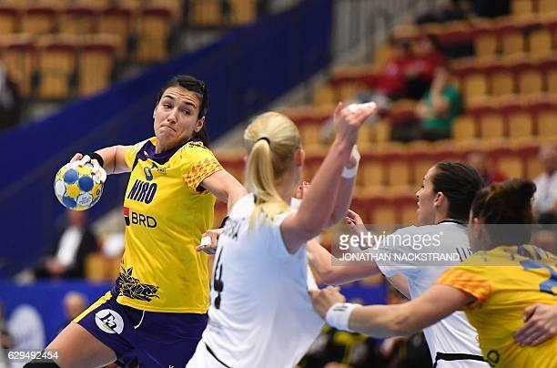 Romania's Cristina Neagu prepares to throw the ball during the Women's European Handball Championship Group II match between Czech Republic and...