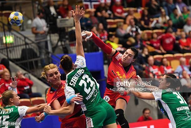 Romania's Cristina Neagu throws the ball during the Women's European Handball Championship Group II match between Hungary and Romania in Helsingborg...
