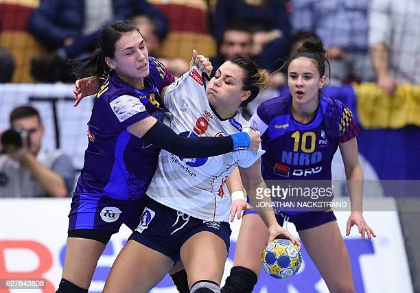 Romania's Cristina Neagu vies with Norway's Nora Mork during the Women's European Handball Championship Group D match between Norway and Romania in...