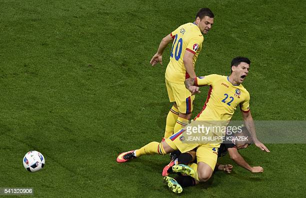 TOPSHOT Romania's defender Cristian Sapunaru is challenged by Albania's defender Andi Lila during the Euro 2016 group A football match between...