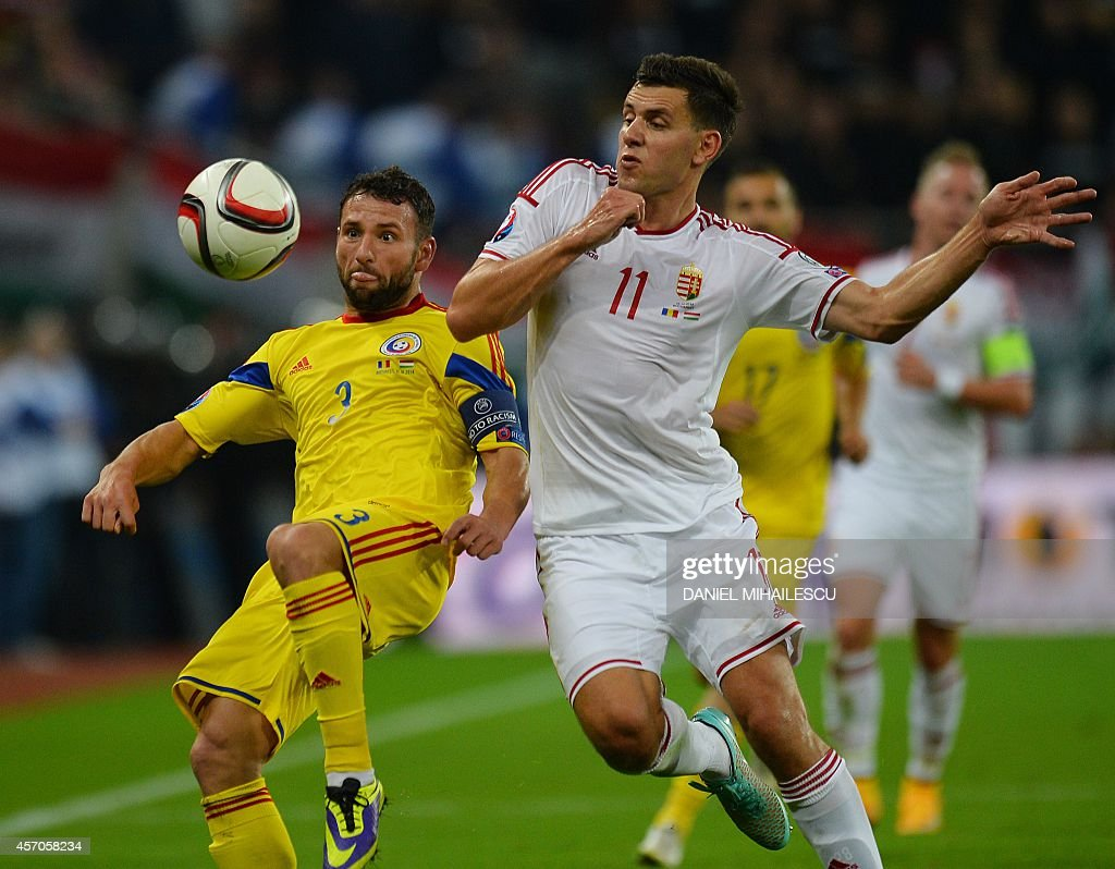 Romania's defender Razvan Rat and Hungary's forward Adam Szalai vie for the ball during the Euro 2016 Group F qualifying football match Romania vs...