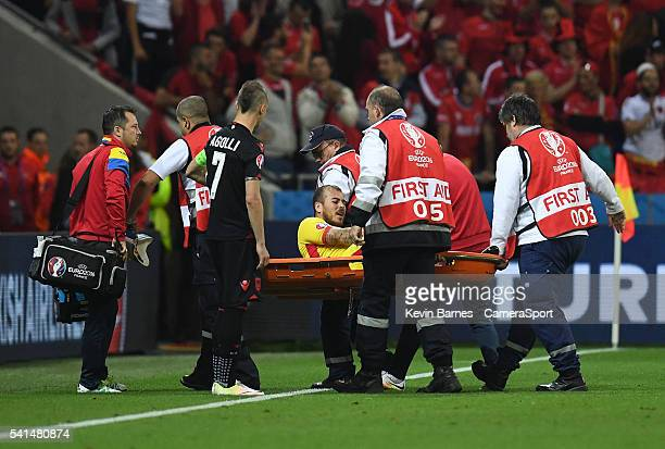 Romania's Denis Alibec is stretchered off during the UEFA Euro 2016 Group A match between Romania and Albania at Stade de Lyon on June 19 in Lyon...