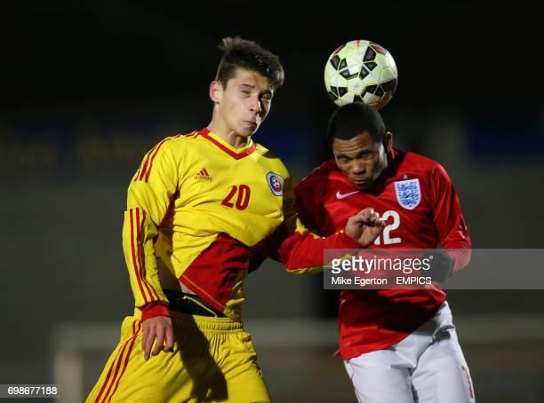 Romania's Dobre Mihai Alexandru and England's Dasilva Jay battle for the ball