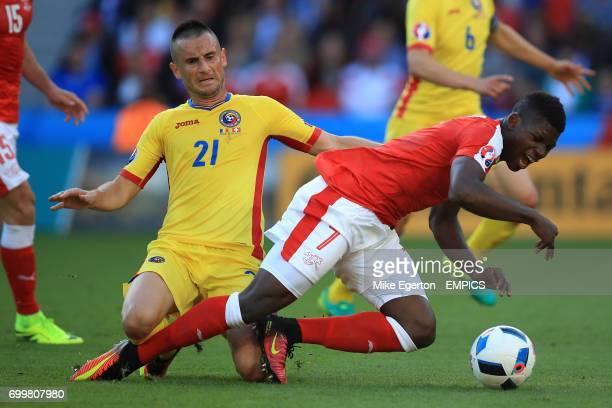 Romania's Dragos Grigore and Switerland's Breel Embolo battle for the ball