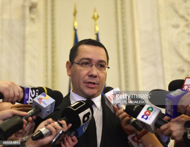 Romania's embattled Prime Minister Victor Ponta addresses journalists as he gets out from the governmental coalition meeting at the Parliament Palace...