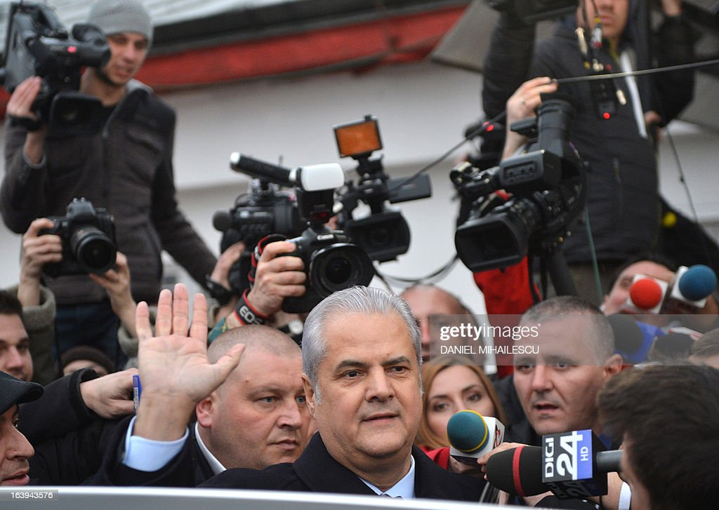 Romania's ex-prime minister Adrian Nastase salutes as he is relaesed from prison in Bucharest March 18, 2013. Nastase who is serving a two-year prison sentence for graft was granted early release Monday by a Bucharest court. Nastase, 62, has served a third of his jail time and is entitled to leave prison, according to Romanian legislation.Nastase, who headed the Social-Democrat government between 2000 and 2004, was convicted in June for siphoning off funds totaling about 1.5 million euros ($1.8 million) for his 2004 re-election campaign.Prosecutors said public institutions and private companies were pressured into taking part in a 2004 construction contest with participation fees passing through several accounts before ending up paying for Nastase's presidential campaign posters. He has always denied the charges saying he was victim of a 'political trial'.