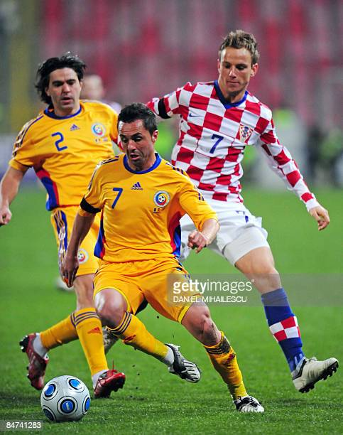 Romania's Florentin Petre controls the ball as Croatia's Ivan Rakitic and Romania's Cosmin Contra follow him during their friendly World Cup 2010...