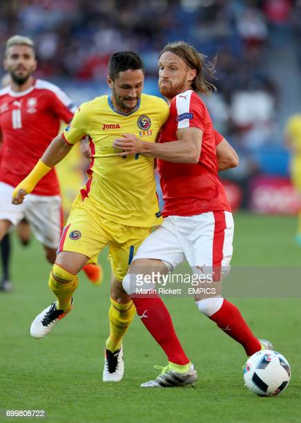 Romania's Florin Andone and Switzerland's Michael Lang battle for the ball