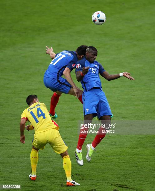 Romania's Florin Andone France's Laurent Koscielny and France's Paul Pogba battle for the ball