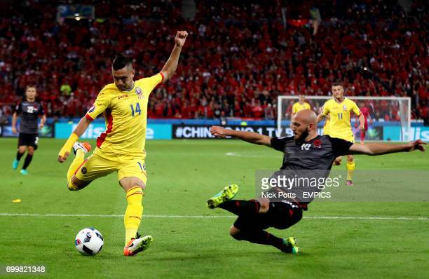 Romania's Florin Andone has an attempt on goal as Albania's Arlind Ajeti slides in
