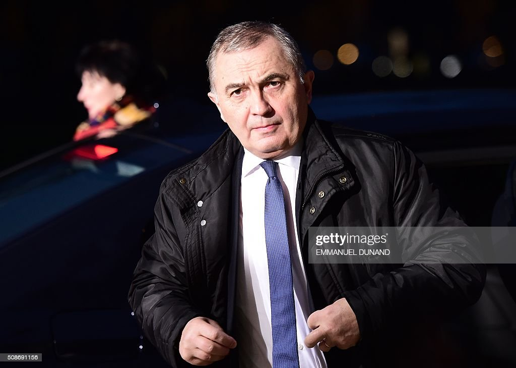 Romania's Foreign Minister Lazar Comanescu arrives to take part in a EU foreign ministers meeting in Amsterdam, on February 6, 2016. The European Union on Wednesday finally reached agreement on how to finance a three-billion-euro ($3.3-billion) deal to aid Syrian refugees in Turkey, in exchange for Ankara's help in stemming the flow of migrants. / AFP / EMMANUEL DUNAND