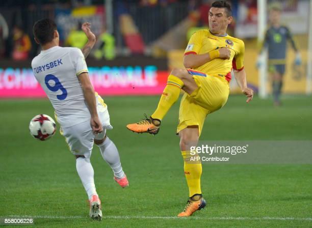 Romania's forward Claudiu Keseru shoots past Kazakhstan's midfielder Bauyrzhan Turysbek during the FIFA 2018 World Cup qualifying football between...