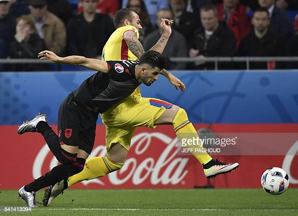 TOPSHOT Romania's forward Denis Alibec vies with Albania's defender Elseid Hysaj during the Euro 2016 group A football match between Romania and...