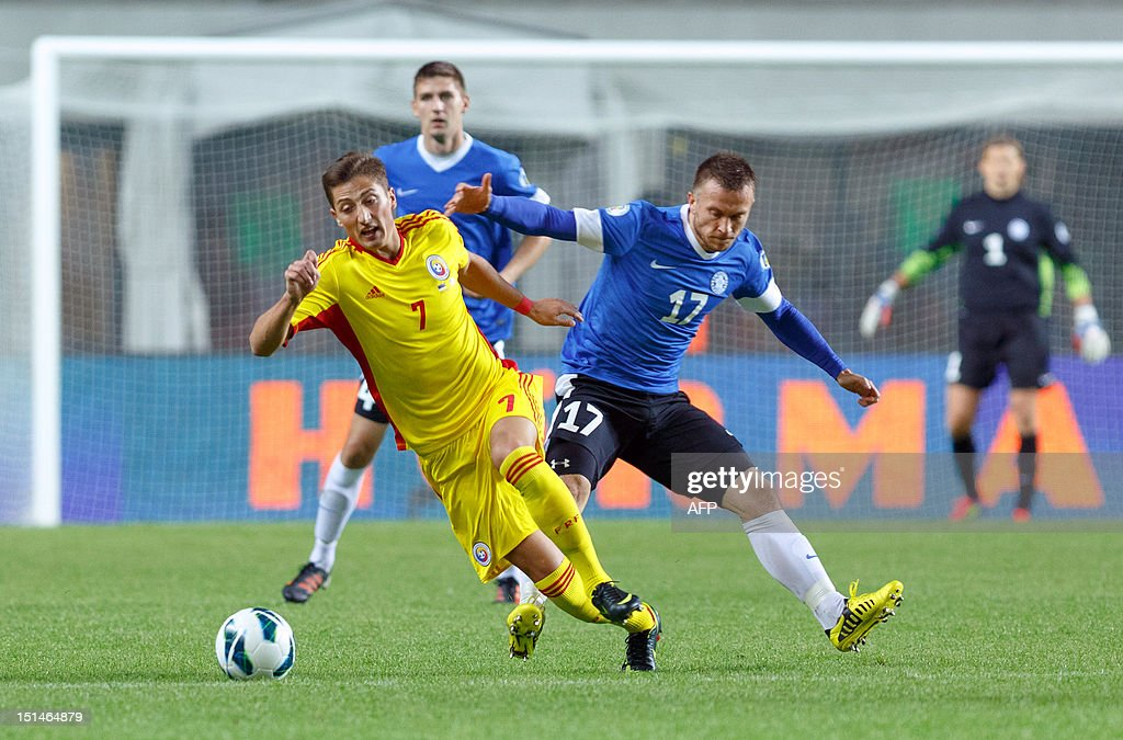Romania's Gheorghe Grozav (L) vies with Estonia's Enar Jaager during the FIFA 2014 World Cup qualifying football match Estonia vs. Romania on September 7, 2012 in Tallin. Romania won 2-0. AFP PHOTO / Jarek Joepera