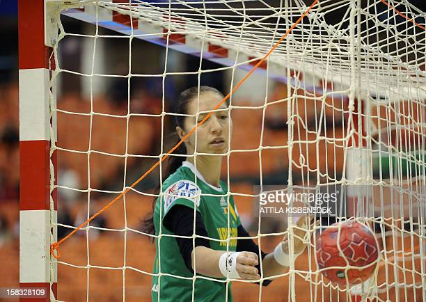 Romania's goalkeeper Talida Tolnai collects the ball against Germany during the 2012 EHF European Women's Handball Championship Group II match of...