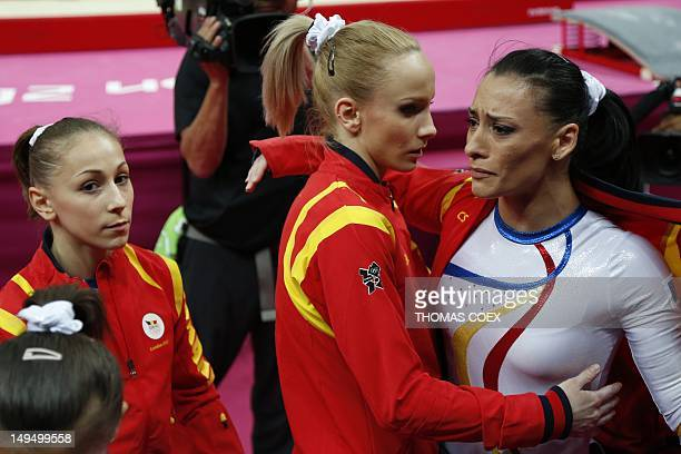 Romania's gymnast Catalina Ponor reacts after perforrming during the women's qualification of the artistic gymnastics event of the London Olympic...
