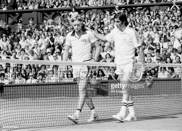 Romania's Ilie Nastase and Bjorn Borg walk off the centre court after the swede defeated Nastase in straight sets in their quarter final clash