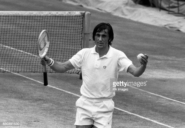 Romania's Ilie Nastase complains of racket tension during his Men's Singles final match at Wimbledon against American's Stan Smith