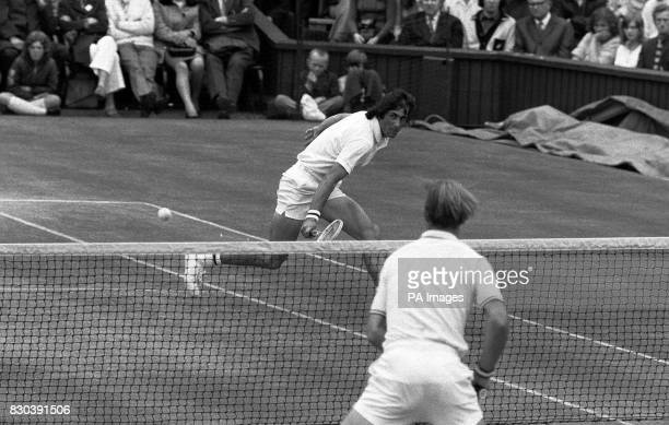 Romania's Ilie Nastase in action during his Men's Singles final match at Wimbledon against American's Stan Smith