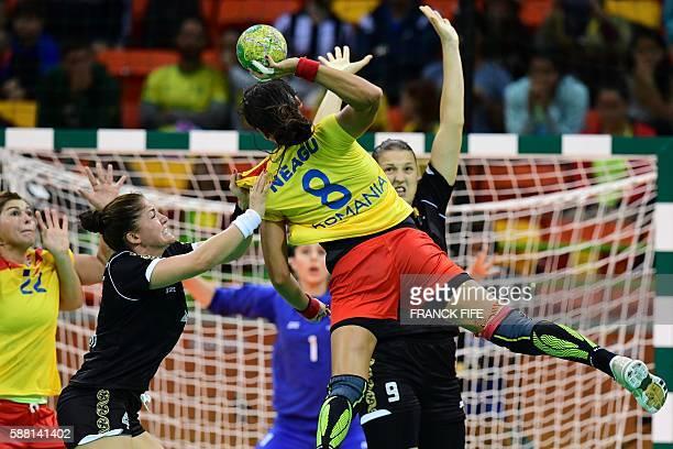 Romania's left back Cristina Neagu jumps to shoot during the women's preliminaries Group A handball match Romania vs Montenegro for the Rio 2016...
