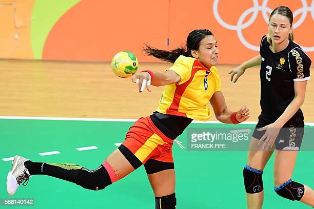 Romania's left back Cristina Neagu jumps to shoot past Montenegro's right wing Radmila Petrovic during the women's preliminaries Group A handball...