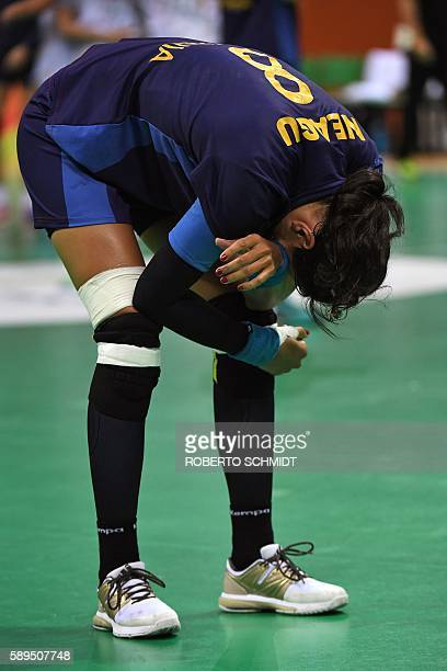 Romania's left back Cristina Neagu reacts after being defeated at the end of the women's preliminaries Group A handball match Norway vs Romania for...