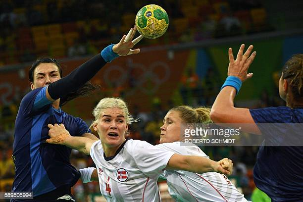 Romania's left back Cristina Neagu shoots past Norway's left back Veronica Kristiansen during the women's preliminaries Group A handball match Norway...