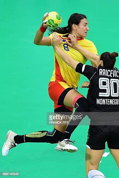 Romania's left back Cristina Neagu vies with Montenegro's left back Milena Raicevic during the women's preliminaries Group A handball match Romania...