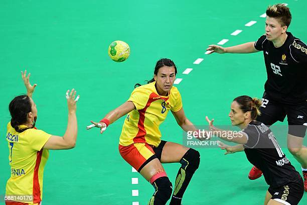 Romania's left back Cristina Neagu vies with Montenegro's pivot Suzana Lazovic and Montenegro's centre back Andela Bulatovic during the women's...