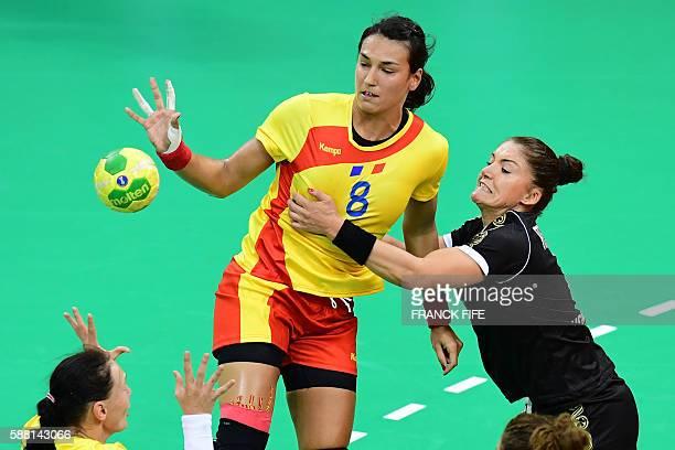 Romania's left back Cristina Neagu vies with Montenegro's right wing Jovanka Radicevic during the women's preliminaries Group A handball match...