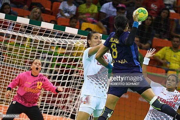 Romania's left back Cristina Neagu vies with Spain's pivot Elizabet Chavez Hernandez and Spain's left back Marta Mangue Gonzalez during the women's...