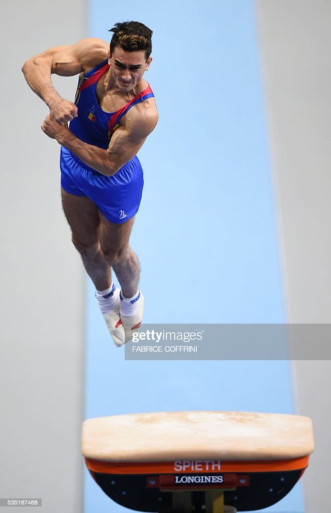 Romanias Marian Dragulescu performs during the Mens Vault competition of the European Artistic Gymnastics Championships 2016 in Bern, Switzerland on May 29, 2016. / AFP / FABRICE