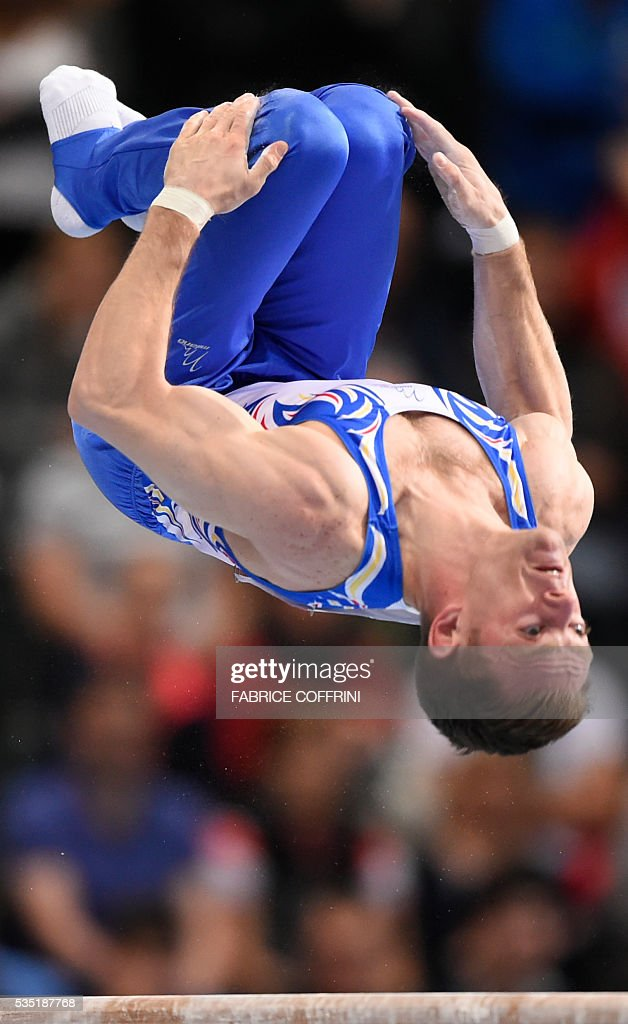 Romanias Marius Daniel Berbecar performs during the Mens Parallel Bars competition of the European Artistic Gymnastics Championships 2016 in Bern, Switzerland on May 29, 2016. / AFP / FABRICE