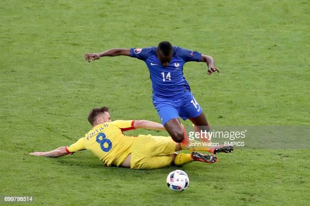 Romania's Mihai Pintilii and France's Blaise Matuidi battle for the ball