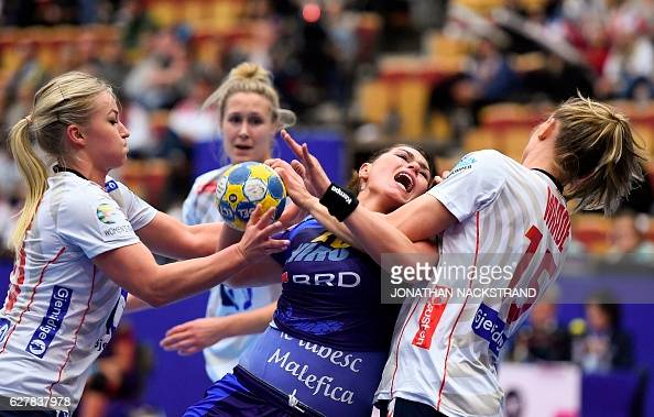 TOPSHOT Romania's Oana Manea vies with Norway's Stine Oftedal and Silje Waade during the Women's European Handball Championship Group D match between...