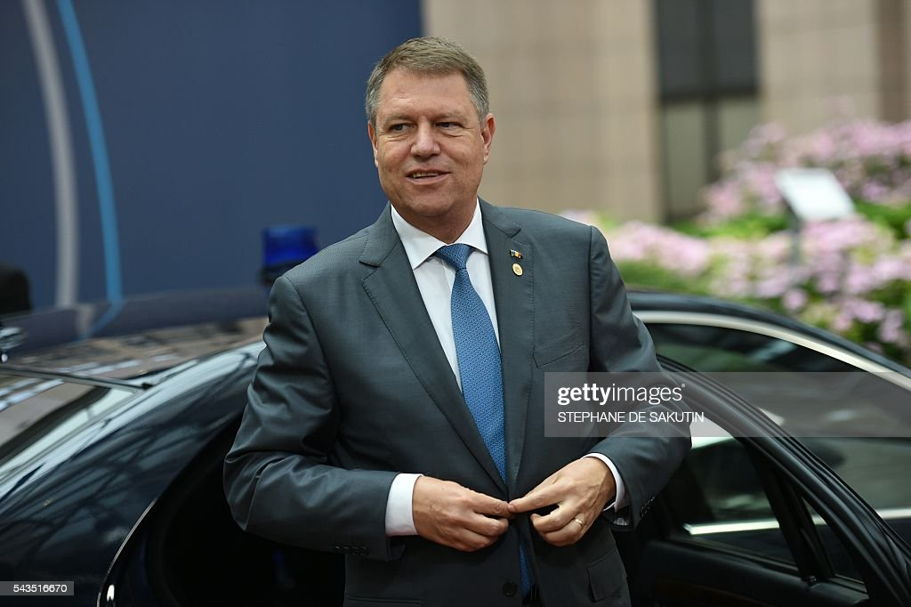 Romania's President Klaus Werner Iohannis arrives for the second day of an EU - Summit at the EU headquarters in Brussels on June 29, 2016. European Union leaders will on June 29, 2016 assess the damage from Britain's decision to leave the bloc and try to prevent further disintegration, as they meet for the first time without a British representative. / AFP / STEPHANE