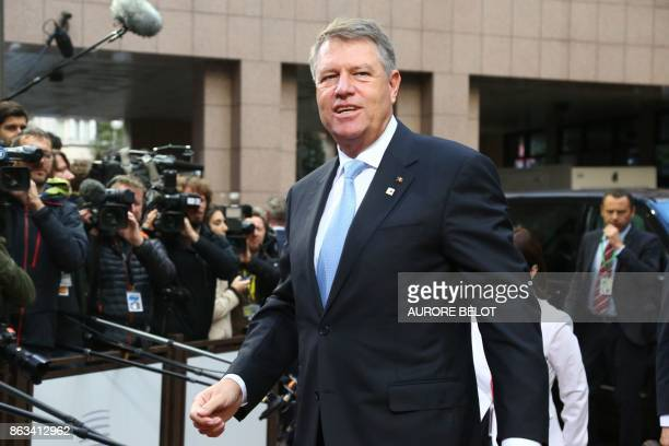 Romania's President Klaus Werner Iohannis arrives on the second day of a summit of European Union leaders in Brussels on October 20 2017 The EU is...