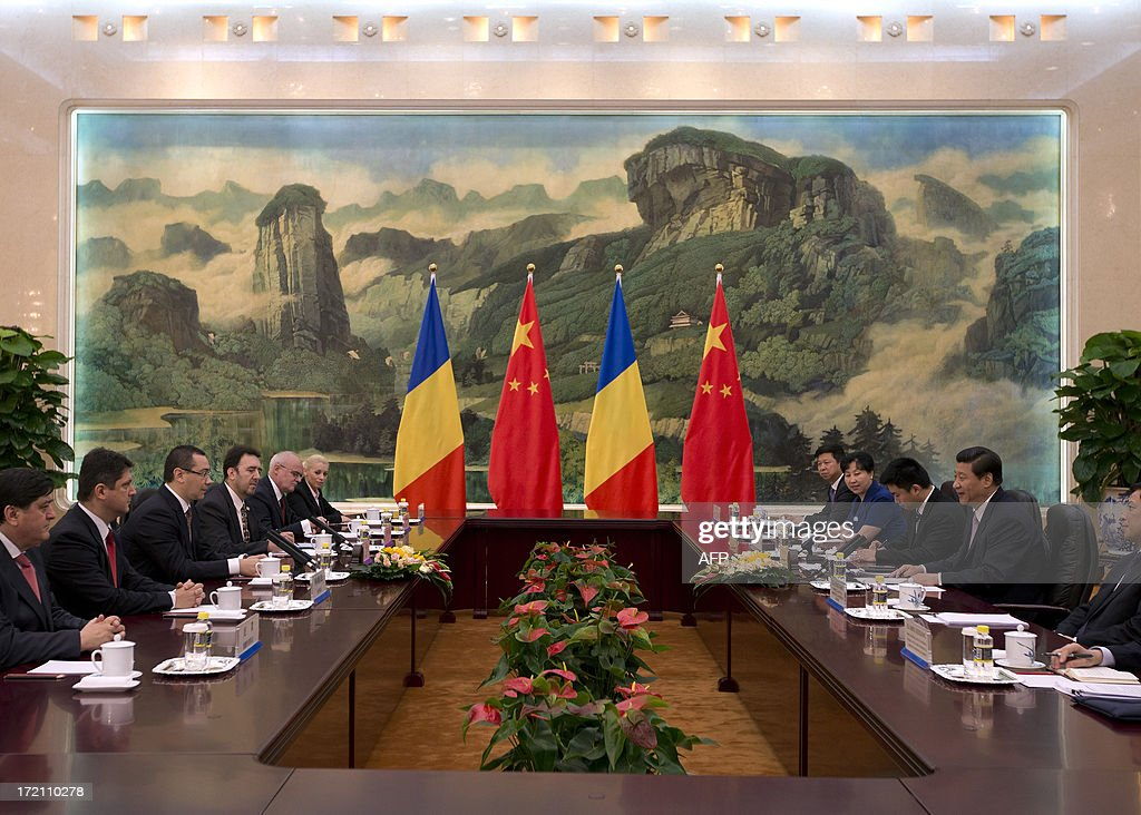 Romania's Prime Minister Victor-Viorel Ponta (3rd L) attends a meeting with Chinese President Xi Jinping (2nd R) at the Great Hall of the People in Beijing on July 2, 2013. Ponta, on an official tour of several Asian countries, is seeking to attract Chinese investments in Romania. AFP PHOTO / Andy Wong / POOL