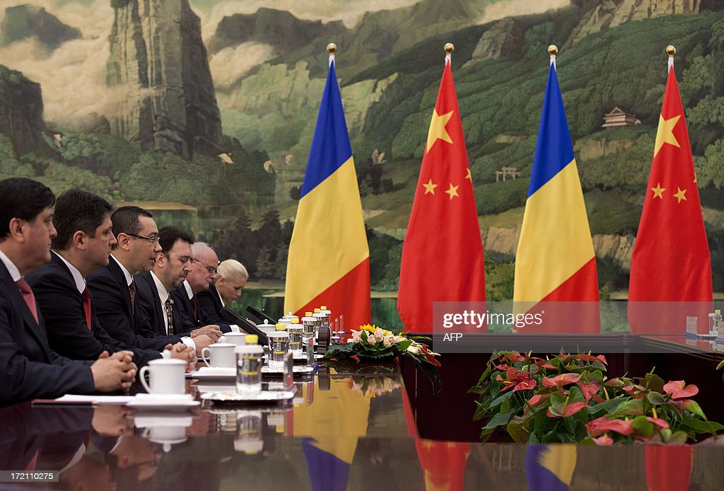 Romania's Prime Minister Victor-Viorel Ponta (3rd L) speaks during with Chinese President Xi Jinping (not in picture) at the Great Hall of the People in Beijing on July 2, 2013. Ponta, on an official tour of several Asian countries, is seeking to attract Chinese investments in Romania. AFP PHOTO / Andy Wong / POOL